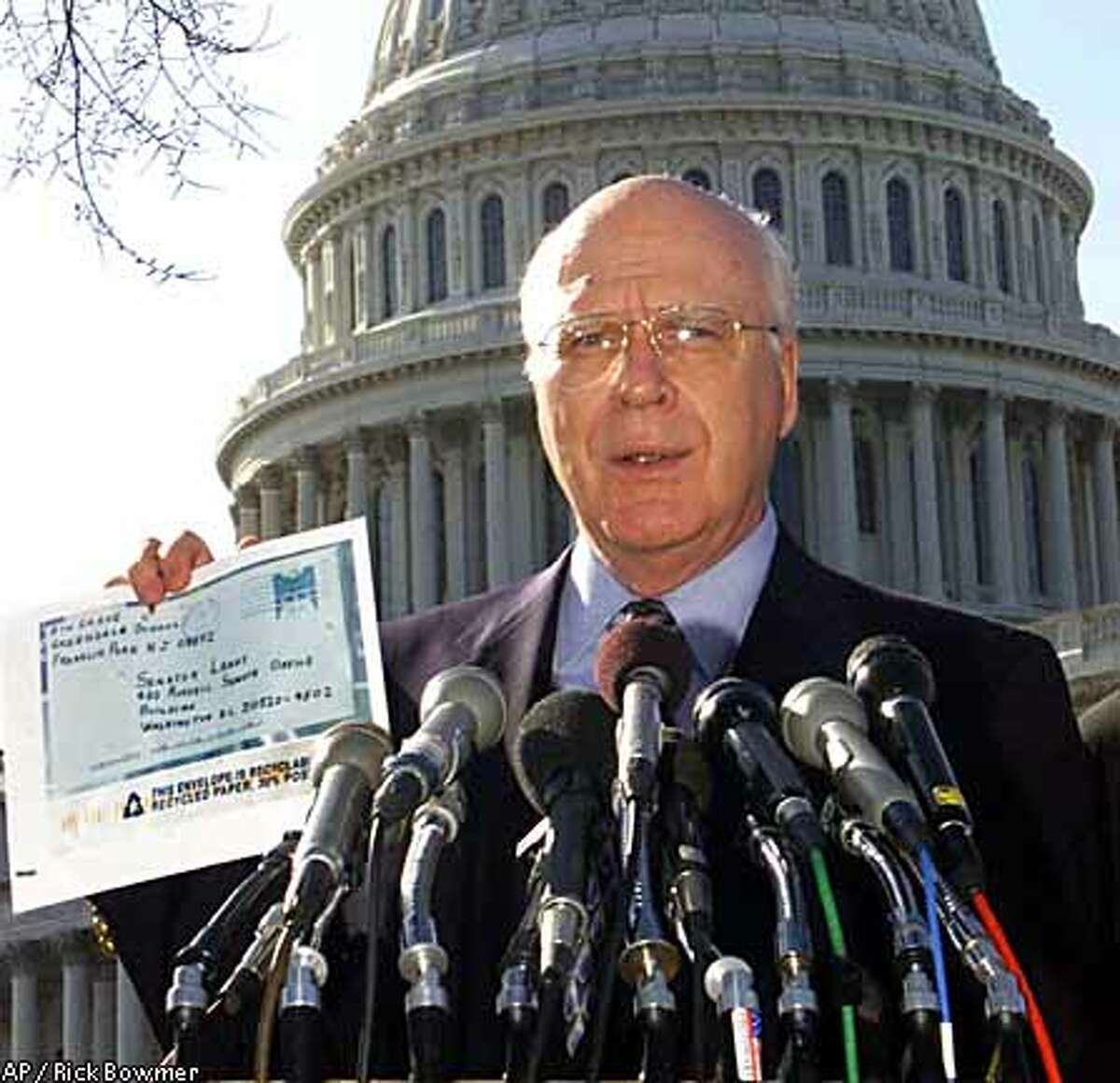 Sen. Patrick Leahy, D-Vt., holds up a copy of a letter that was sent to his office.