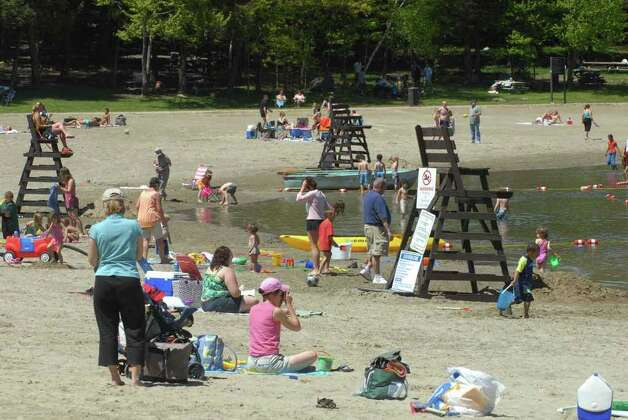 Visitors enjoy the sun and the sand at Grafton Lakes State Park in