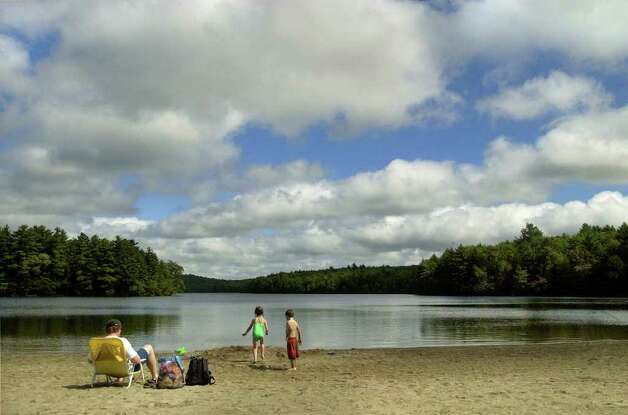 Chris Einstein, left, and his children Rose, 6, center, and Nate, 4, from Colonie, virtually had the Long Pond beach at Grafton lakes State Park to themselves Tuesday lunchtime, September 7, 2004. (Will Waldron / Times Union archive) Photo: WILL WALDRON / ALBANY TIMES UNION