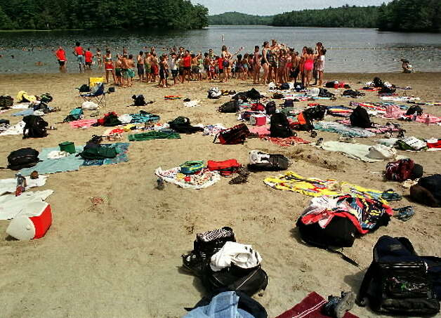 Summertime visitors crowd the beach at Grafton Lakes State Park.