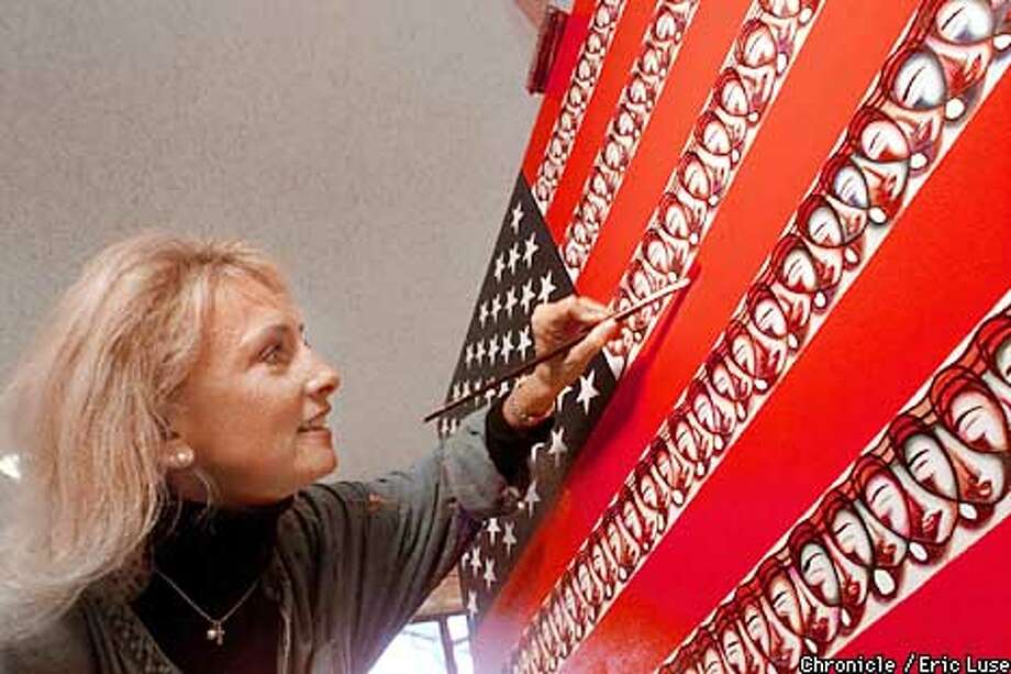 "San Anselmo artist Vivianne Nantel puts some finishing touches to her version of the American flag called ""United as One"" an oil on canvas (36X60"") which she plans to present to the American people as a gift with the help of Senator Diane Feinstein. Nantel's phone # 415.453.5359. BY ERIC LUSE/THE CHRONICLE Photo: ERIC LUSE"