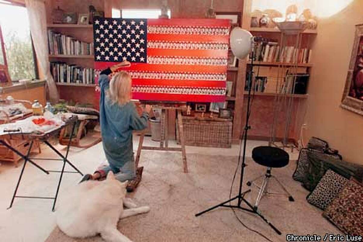 San Anselmo artist Vivianne Nantel puts some finishing touches to her version of the American flag called
