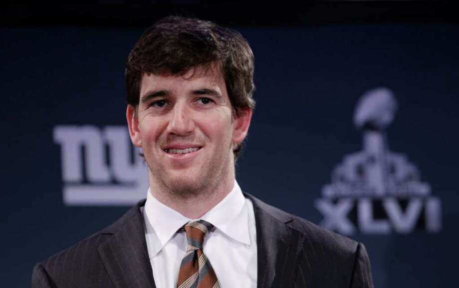 New York Giants' Eli Manning answers questions during a news conference, Monday, Jan. 30, 2012, in Indianapolis. The Giants will face the New England Patriots in the NFL football Super Bowl XLVI  on Feb. 5.(AP Photo/Eric Gay) Photo: Eric Gay