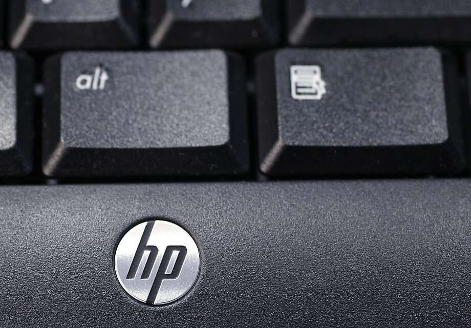 This Nov. 14, 2011 photo, shows the company logo on a Hewlett-Packard keyboard at the Micro Center computer store in Santa Clara, Calif. Hewlett-Packard releases quarterly financial results Monday, Nov. 21, 2011, after the market close. Photo: Paul Sakuma, AP