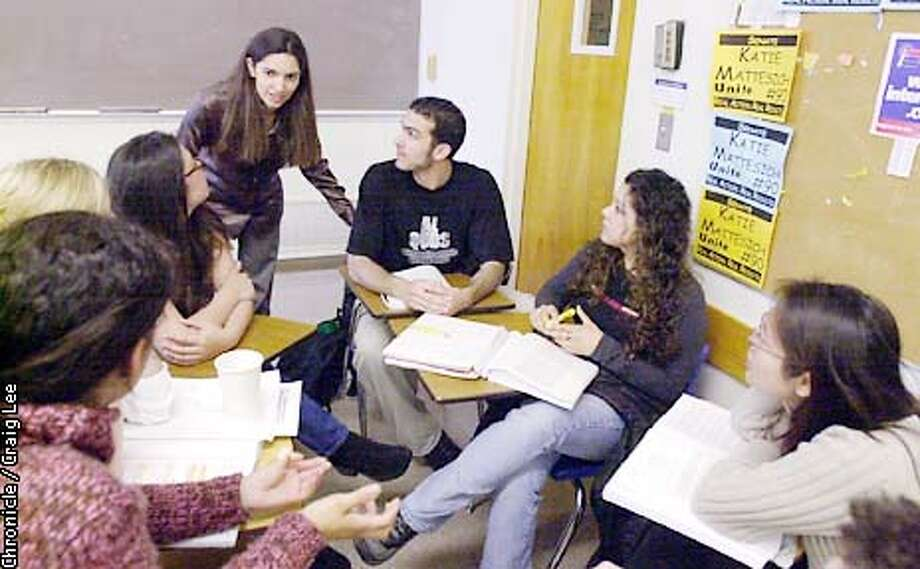 Photo of a class called International Law, the teacher standing up at the left is Nina Rathbun. The man to the right of her is Basim Elkarra, President of the Muslim Student Association. Students discussing the Palestine/Israel conflict at UC Berkeley. Tanya Schevitz was the Chronicle reporter.  Photo by Craig Lee/San Francisco Chronicle Photo: CRAIG LEE
