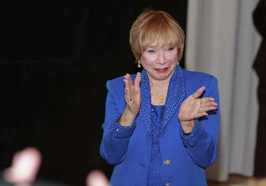 "(For the Chronicle/Gary Fountain, November 13, 2010)  Academy Award-winning actress Shirley MacLaine reacts to the audience after a screening of ""Terms of Endearment,"" at the MFAH Brown Auditorium Theater for Cinema Arts Festival Houston. Photo: Gary Fountain / Freelance"