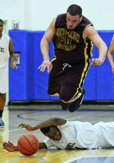 Berne Knox Westerlo's Tyler Sigond jumps over Mekeel Christian's Ohieno Miller during their game on