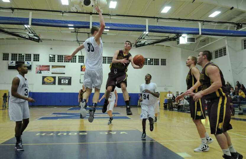 Berne Knox Westerlo's Mike Gamble drives to the basket as Mekeel Christian's Collin Stewart defends