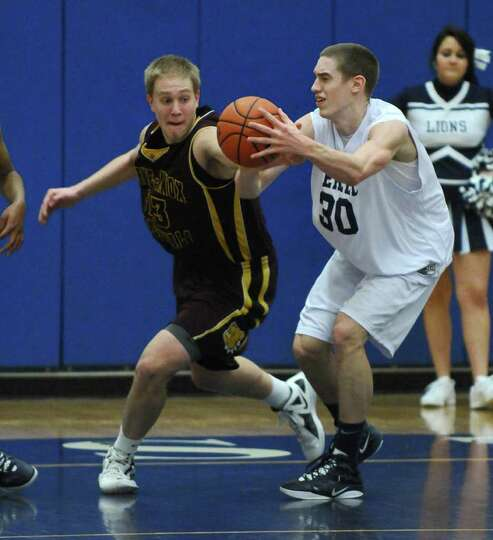 Berne Knox Westerlo's Nate Krimsky, left, battles Mekeel Christian's Collin Stewart for the ball dur