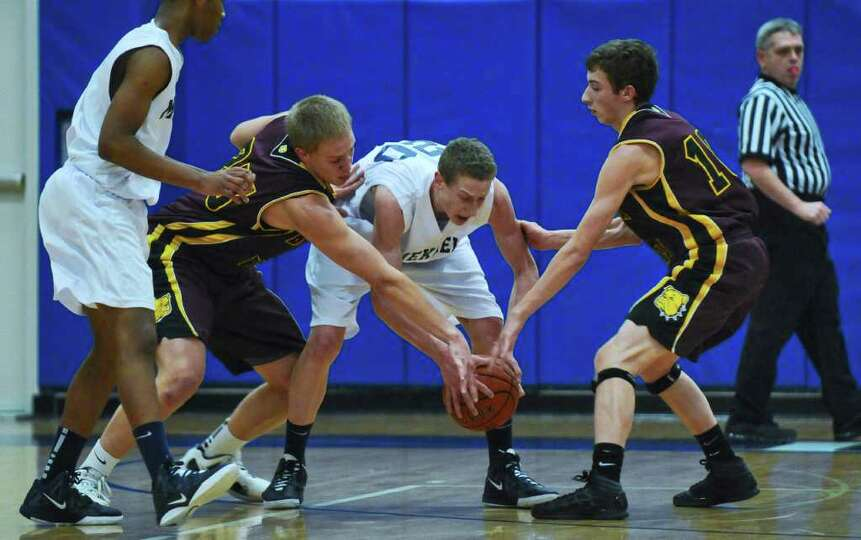 Berne Knox Westerlo's Nate Krimsky, left, and Tristan Wilson, right, battle Mekeel Christian's Colli