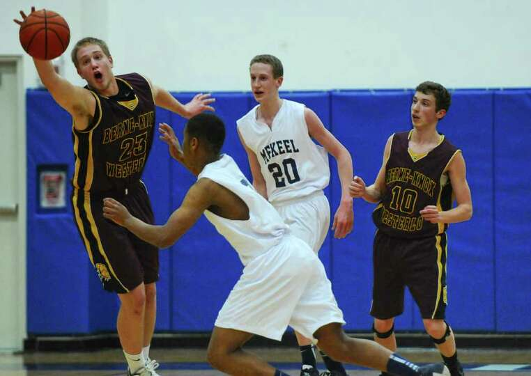 Berne Knox Westerlo's Nate Krimsky, left, gathers in a loose ball near teammate Tristan Wilson, righ