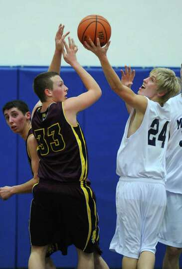 Berne Knox Westerlo's Garrett Pitcher, left, and Mekeel Christian's Spencer Bath, right,  battle for
