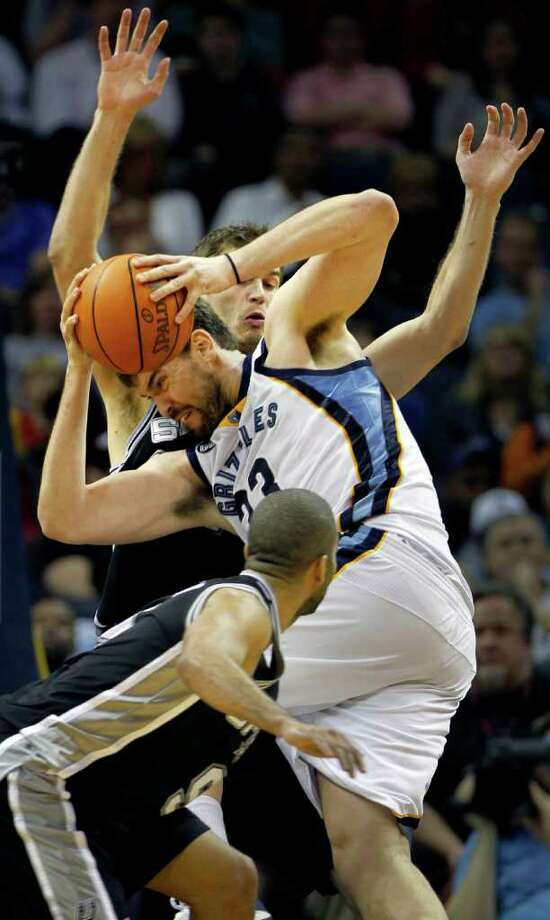 Memphis Grizzlies center Marc Gasol (33), of Spain, runs into San Antonio Spurs forward Tiago Splitter (22), of Brazil, in the second half of an NBA basketball game on Monday, Jan. 30, 2012, in Memphis, Tenn. The Spurs won 83-73. (AP Photo/Jim Weber) Photo: Associated Press