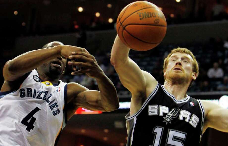 San Antonio Spurs guard Matt Bonner (15) stretches for a rebound under pressure by Memphis Grizzlies guard Sam Young (4) in the second half of an NBA basketball game on Monday, Jan. 30, 2012, in Memphis, Tenn. The Spurs won 83-73. (AP Photo/Jim Weber) Photo: Associated Press