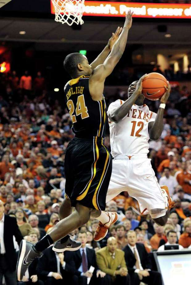Texas guard Myck Kabongo (12) shoots against Missouri guard Kim English during the second half of an NCAA college basketball game, Monday, Jan. 30, 2012, in Austin, Texas. Missouri won 67-66. (AP Photo/Michael Thomas) Photo: Michael Thomas, Associated Press / FR65778 AP