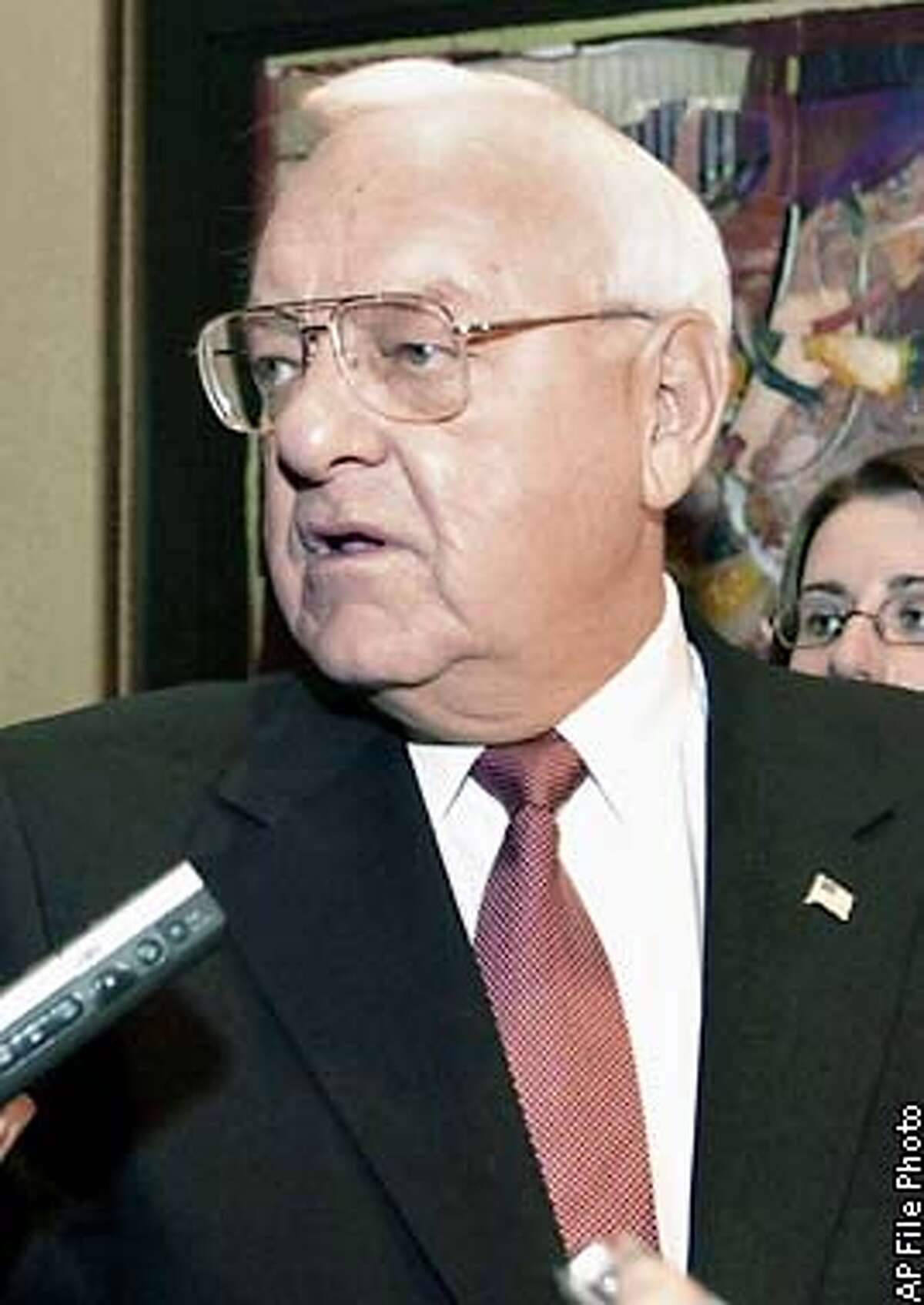 FILE - Illinois Gov. George Ryan is seen at a Republican party news conference, March 20, 2002, in Chicago. On Tuesday, April 2, 2002, two of Ryan's former top aides were indicted on federal charges that alleged his campaign committee was a corrupt enterprise that illegally used state workers for political purposes. It is the biggest indictment to come out of the federal government's four-year investigation that began as a probe of the selling of driver's license for bribes when Ryan was secretary of state. (AP Photo/Charles Bennett, File)