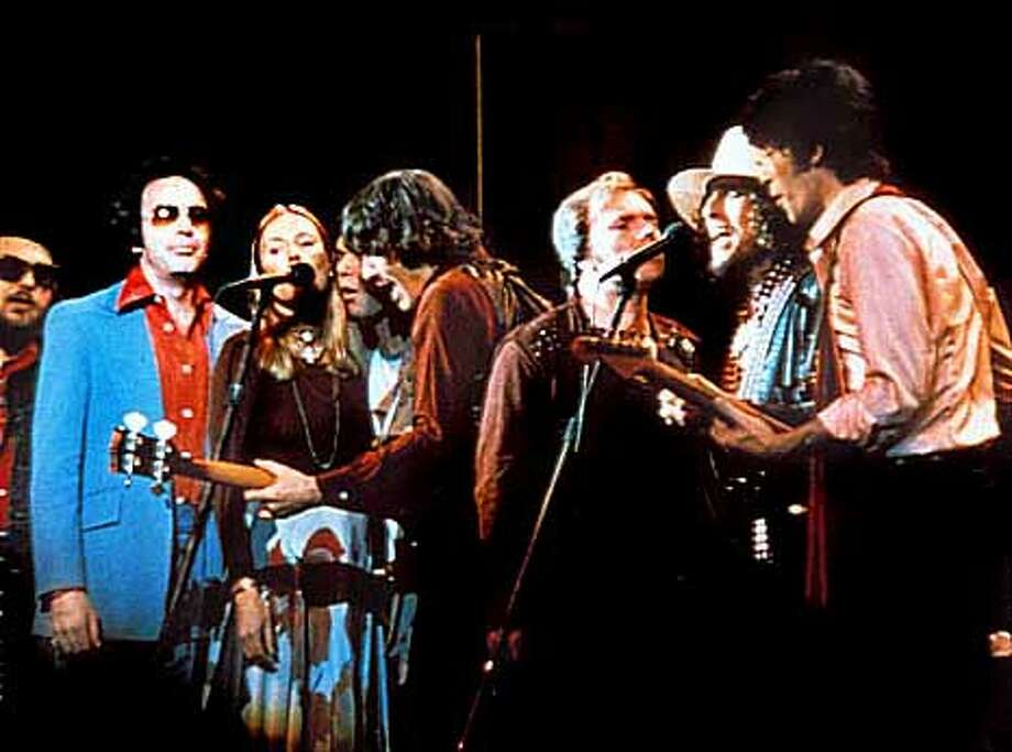 "Among the musical stars onstage for the finale of ""The Last Waltz"" were Dr. John (from left), Neil Diamond, Joni Mitchell, Neil Young, Rick Danko, Van Morrison, Bob Dylan and Robbie Robertson."