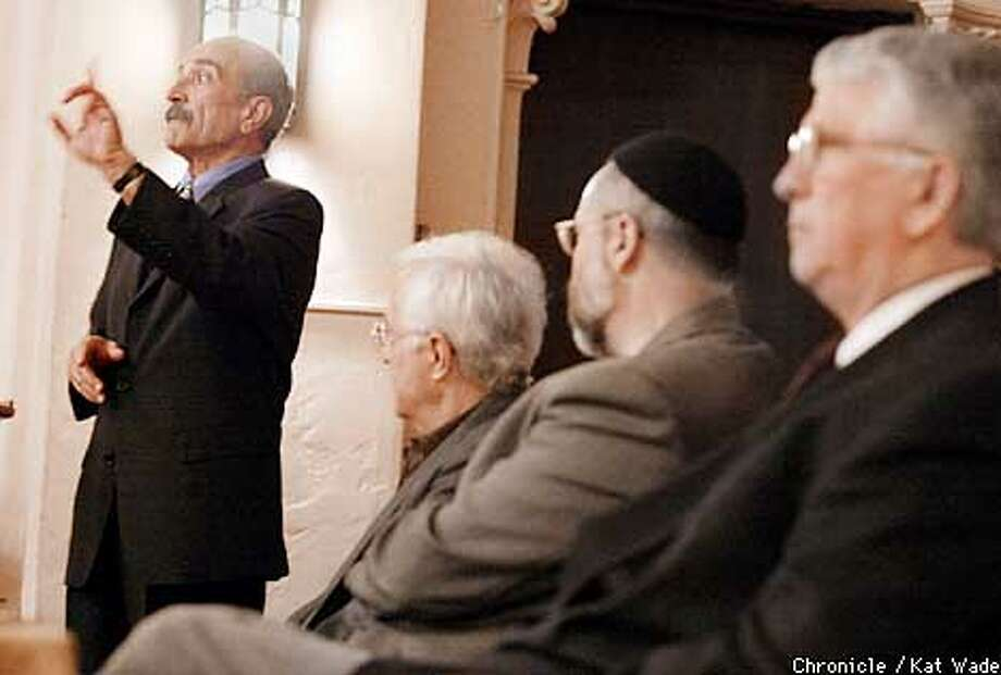 "(L to R) Dr. Ali Kanifar, from the institute of Sufi studies in Novato expresses his points about interfaith understanding while facilitator Glen Pascall, and other panelists Rabbi Rami Shapiro, from the Metivta Center of Contemplative Judaism in Los Angeles and Christian representative, Dr. Jame Conlon from College of Holy Names in Oakland listen attentively during the interfaith discussion on ""Inner Peace for Global Healing"" presented by the Institute for Sufi Studies at the Main Post Chapel at the Precidio in San Francisco on Easter Sunday. SAN FRANCISCO CHRONICLE PHOTO BY KAT WADE Photo: KAT WADE"