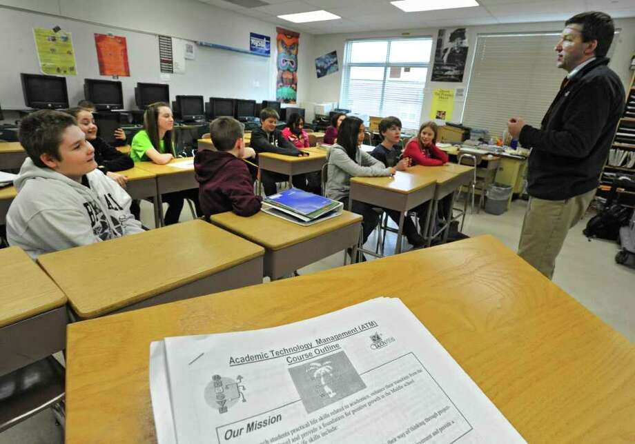 Sixth-grade teacher Tom Michalek talks to students in his Academic Technology Management class on Jan. 30, 2012, at Bethlehem Middle School in Delmar, N.Y.  School districts are exploring or have created foundations, including corporate sponsorships, to pay for programs that no longer are part of school budgets. (Lori Van Buren / Times Union) Photo: Lori Van Buren