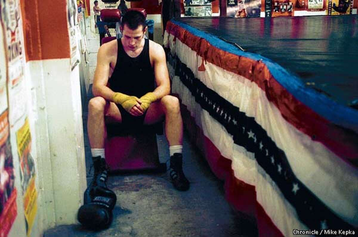 Jacob Bukolich, 27, an east bay artist who said he started boxing training as a way to conect with his frustrations, takes a second to catch his breath at the end of a workout at Kings gym in Oakland. BY MIKE KEPKA/THE CHRONICLE