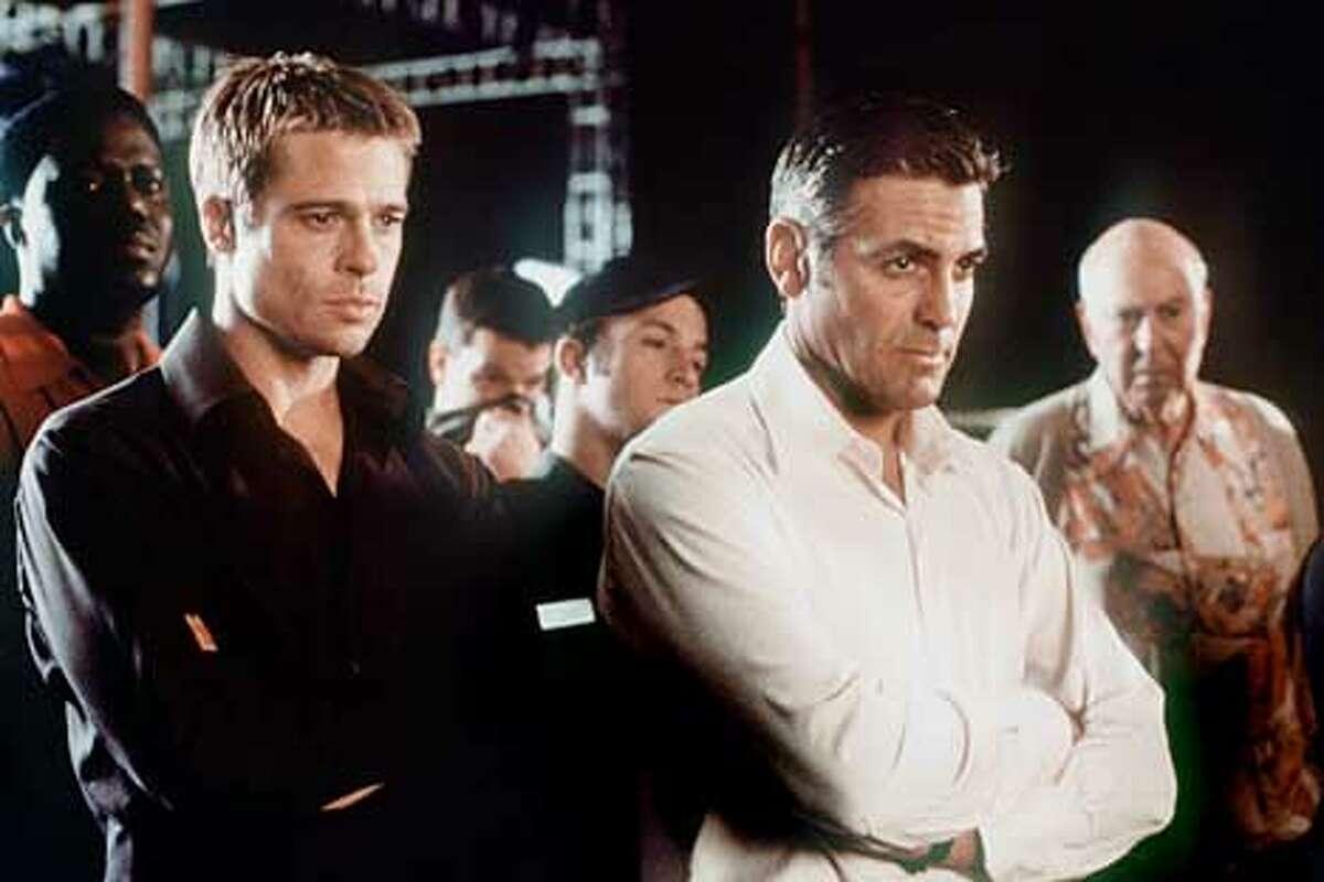"""Ocean's 11"" starring Brad Pitt and George Clooney."