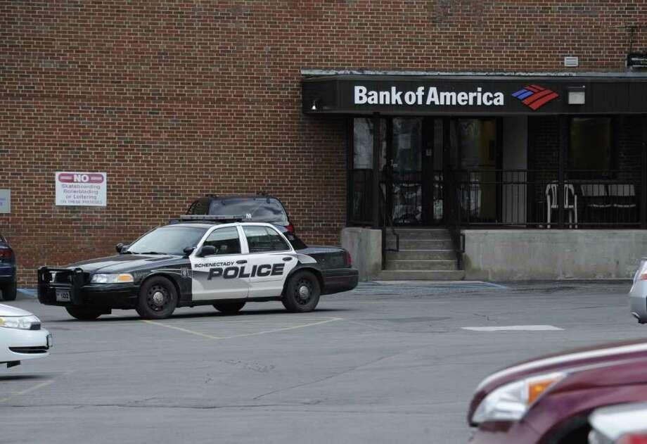 Schenectady Police secure a stabbing scene in the rear of the Bank of America at the intersection of Clinton Street and State Street in the Schenectady, N.Y., Jan. 30, 2012.  A woman died Monday morning after she was stabbed during an argument on Clinton Avenue, police said.  (Skip Dickstein/Times Union) Photo: Skip Dickstein / 2011