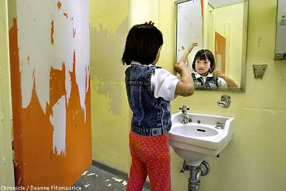 SCHOOLS1-C-24SEP01-SN-DF  Sara Ramos, a first grader at Bessie Carmichael Elementary School in San Francisco fixes her hair after recess in the girls' restroom which has no soap due to a broken dispenser and is in need of paint and cleaning.  CHRONICLE PHOTO BY DEANNE FITZMAURICE Photo: DEANNE FITZMAURICE