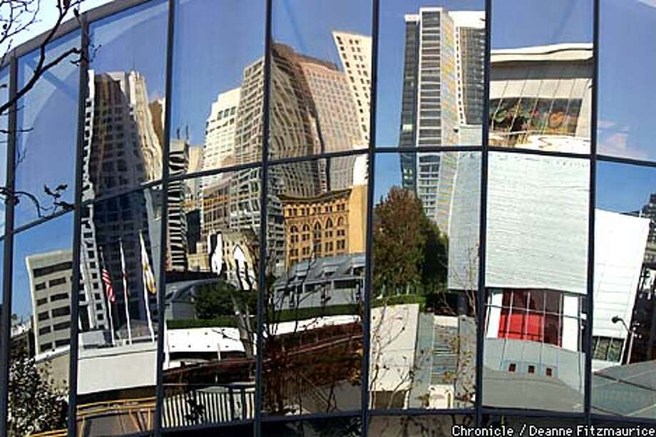 Buildings in Yerba Buena Center and the surrounding area are reflected in the Zeum building at Yerba Buena Center South of Market in San Francisco.  CHRONICLE PHOTO BY DEANNE FITZMAURICE Photo: DEANNE FITZMAURICE