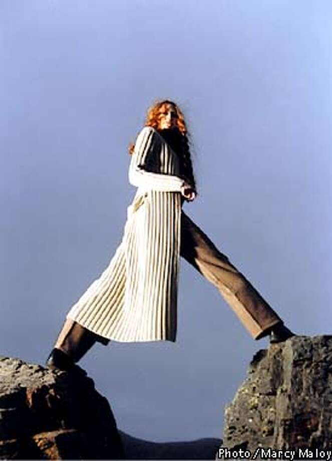 Long, ribbed, camel sweater by Theory, $380, gray/brown/camel cashmere sweater by Urchin, $198, tweed trouser by Gunex, $340, all available at Saks Fifth Avenue, Post and Powell streets, San Francisco. Weathered black boots by MoMa, $198, at Gimme Shoes, 50 Grant Ave., San Francisco. Photo by Marcy Maloy, special to the Chronicle