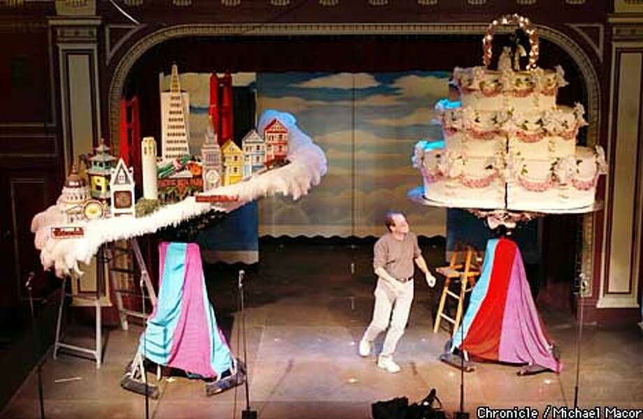 "Alan Greenspan, on the stage of "" Beach Blanket Babylon"", with hats he designed, the San Francisco Skyline and a giant Wedding Cake. Profile on Alan Greenspan, who designs the gigantic hat fro the production of ""Beach Blanket Babylon"". At home he is an avid collector of Mad Hatter items fron Alice in Wonderland, his house is full of it. by Michael Macor/The Chronicle Photo: MICHAEL MACOR"