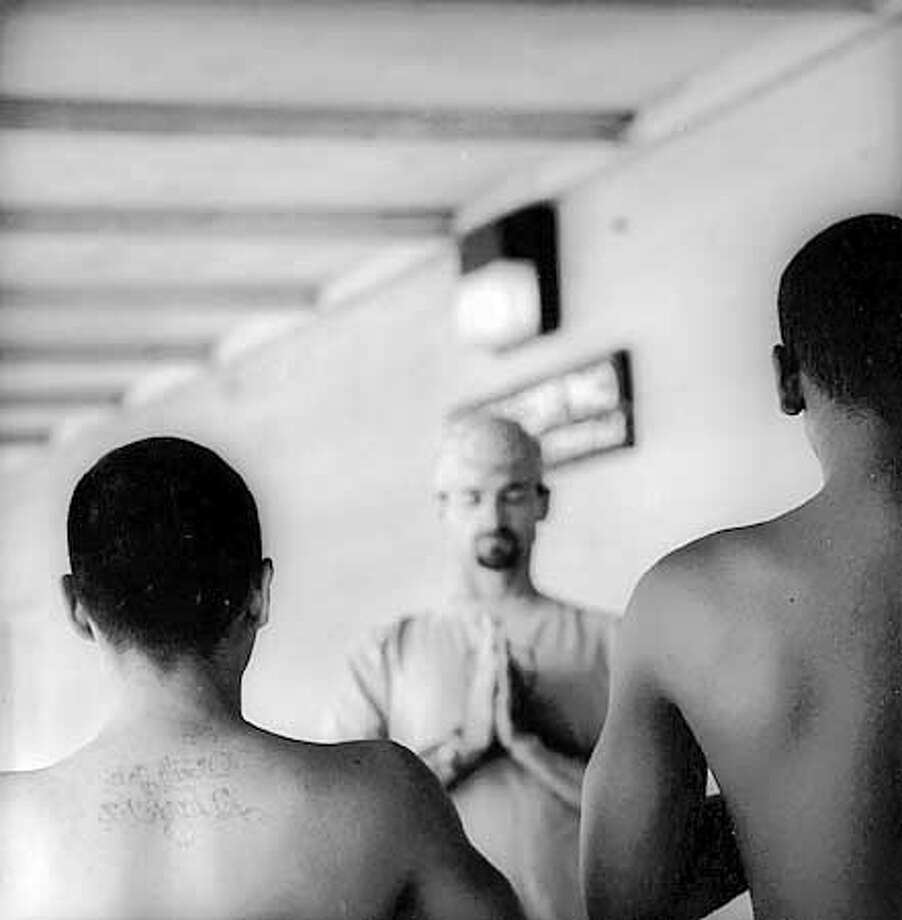 THIS IS A HANDOUT IMAGE. PLEASE VERIFY RIGHTS. A Yoga Inside instructor leads young people at a juvenille detention facility in relaxation techniques.  Courtesy of James Wvinner Photo: James Wvinner