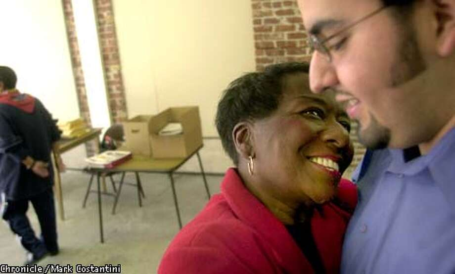 IRMA ANDERSON(CENTER), NEW MAYOR OF RICHMOND, GETS A HUG FROM CAMPAIGN STAFFER SERGIO SERNA AT HER CAMPAIGN HEADQUARTERS IN RICHMOND. PHOTO: MARK COSTANTINI /THE CHRONICLE Photo: MARK COSTANTINI