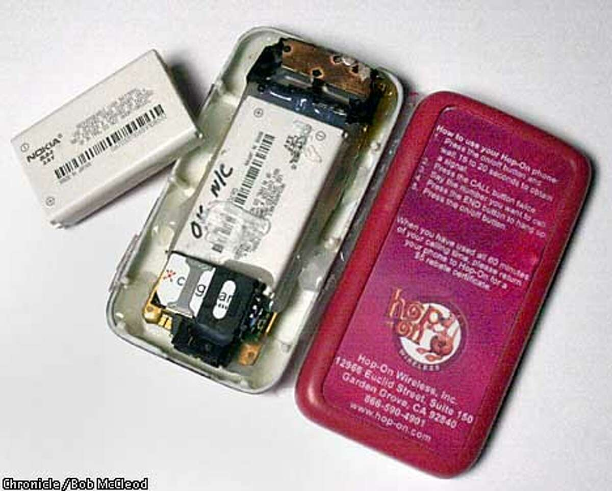 HOPONc-C-21MAR02-BU-BM the new Hop-On disposable phone is just a Nokia inside. note the same battery, but the Hop-On one has Nokia scratched off. chronicle photo by Bob McLeod