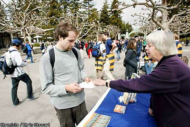 Cal Berkeley student Ben Shaeffer (cq), 23, listens to Peace Corps recruiter Jean Ellisen (cq). Due to the recession and the tragedies of Sept. 11, interest in the Peace Corps has experienced a resurgence among college students. Since President Bush vowed to double the number of Peace Corps recruits in this year's State of the Union Speech, there has been a 39-percent rise in Peace Corps information seekers. BY CHRIS STEWART/THE CHRONICLE Photo: CHRIS STEWART