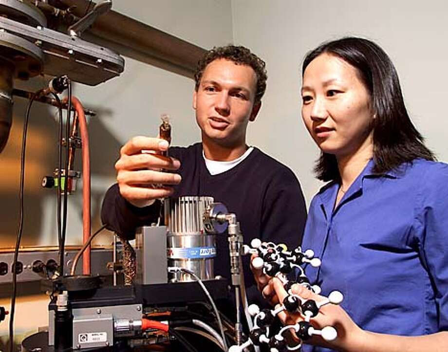 Bell Labs scientists Hendrik Schon and Zhenan Bao, shown here in their Murray Hill, N.J. lab, have fabricated molecular-scale organic transistors.