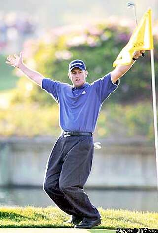 Craig Perks celebrates after making eagle on the 16th hole during the final round of The Sunday afternoon March 24, 2002 at Sawgrass in Ponte Vedra Beach, Fla. Perks won the tournament at 8-under-par. (AP Photo/Chris O'Meara) Photo: CHRIS O'MEARA