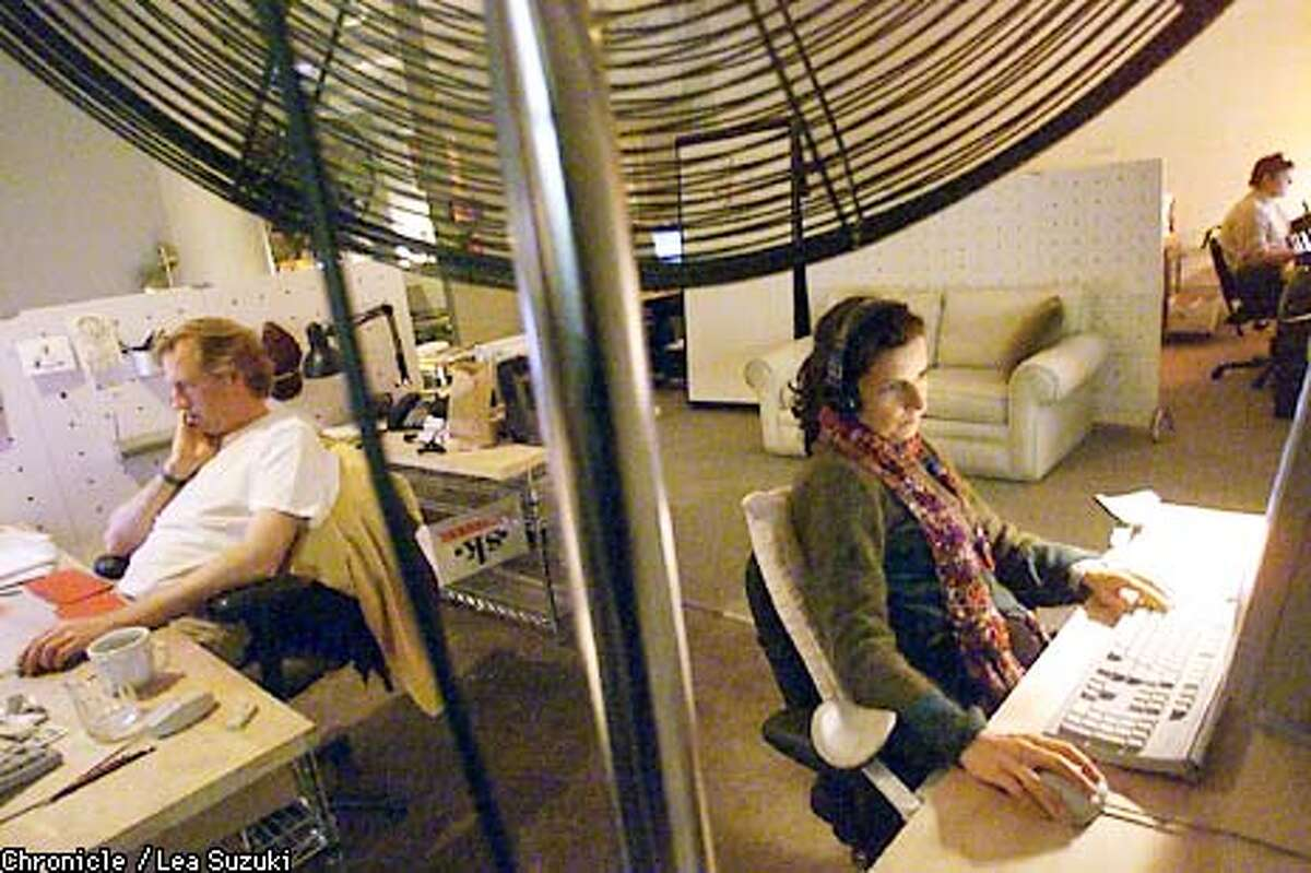 """FROM LEFT: David Brandt, animator, and Raquel Coelho, animator work in the commercial room at Wild Brain in San Francisco. Film special effects used to be the domain of of firms like ILM, but cheaper, high powered desk top computers have opened the door for a half dozen """"garage type"""" Photo by Lea Suzuki/SAN FRANCISCO CHRONICLE"""