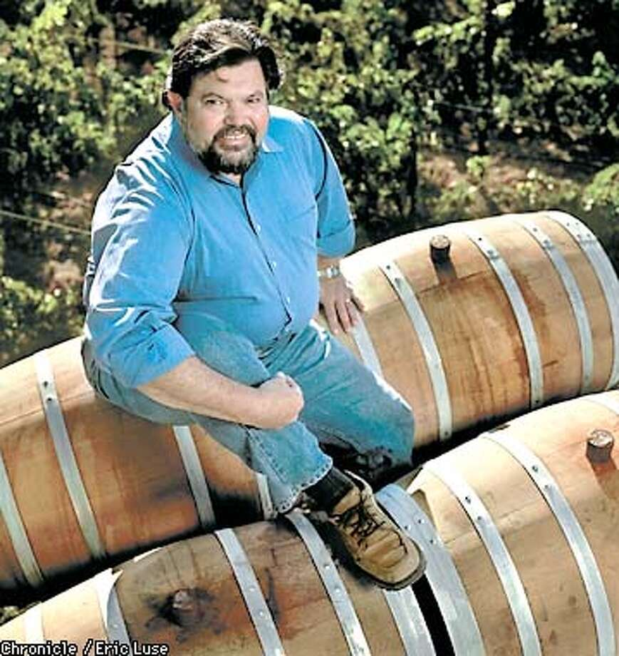 Winemaker of the year Ed Sbragia, winemaker at Beringer sits atop barrels above Beringer's Cabernet Sauvignon vineyard in St. Helena.  BY ERIC LUSE/THE CHRONICLE Photo: ERIC LUSE