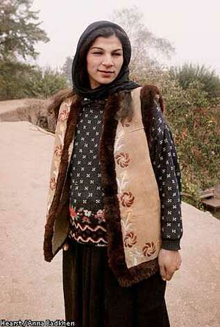 11/02/2001  Dasht-e-Qaleh resident Nargiz, 29, on the roof of her home. Photo by Anna Badkhen/San Francisco Chronicle  Hearst Newspapers
