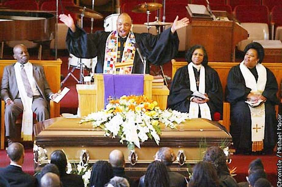 """McGee Baptist Church in Berkeley says goodbye to """"The Berkeley Waving Man"""", who passed away last week at the age of 91. Rev. D. Mark Wilson gives the eulogy for the late Charles. Memorial service for Joseph William Charles Sr. by Michael Macor/The Chronicle Photo: MICHAEL MACOR"""