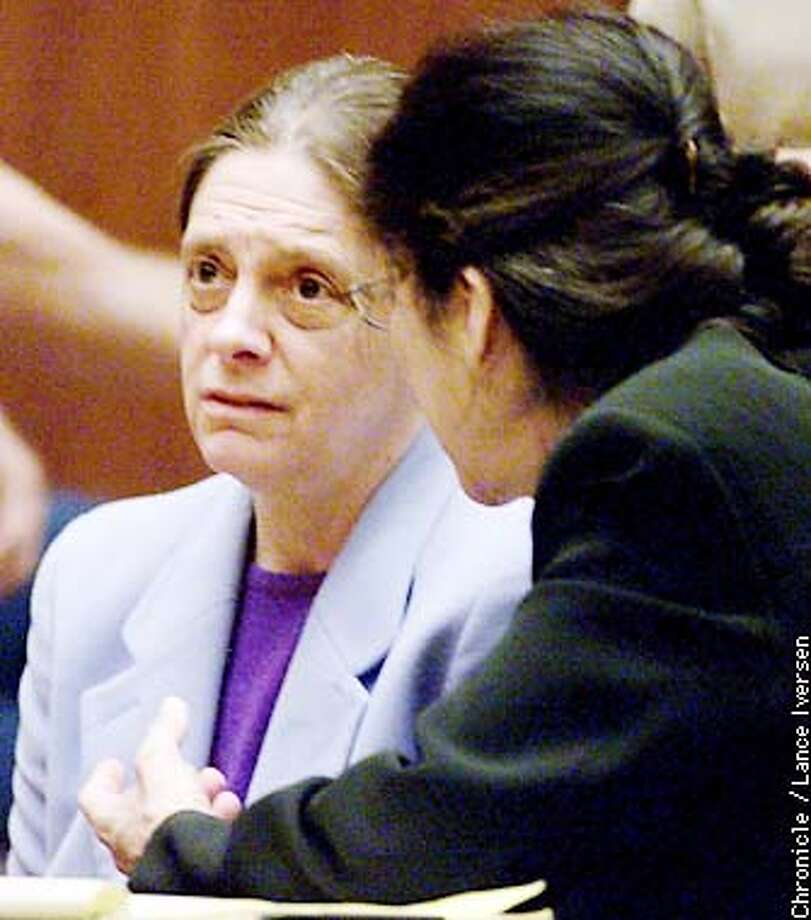 Marjorie Knoller, left, speaks to her attorney Nedra Ruiz, Thursday, March 21, 2002, in a courtroom in Los Angeles, after Knoller was found guilty on charges in connection with the fatal dog mauling of a neighbor. Knoller, whose two huge dogs mauled Diane Whipple to death in a San Francisco apartment building, was convicted of murder and manslaughter Thursday. Knoller's husband was found guilty of manslaughter. (AP Photo/San Francisco Chronicle, Lance Iversen, Pool) Photo: LANCE IVERSEN