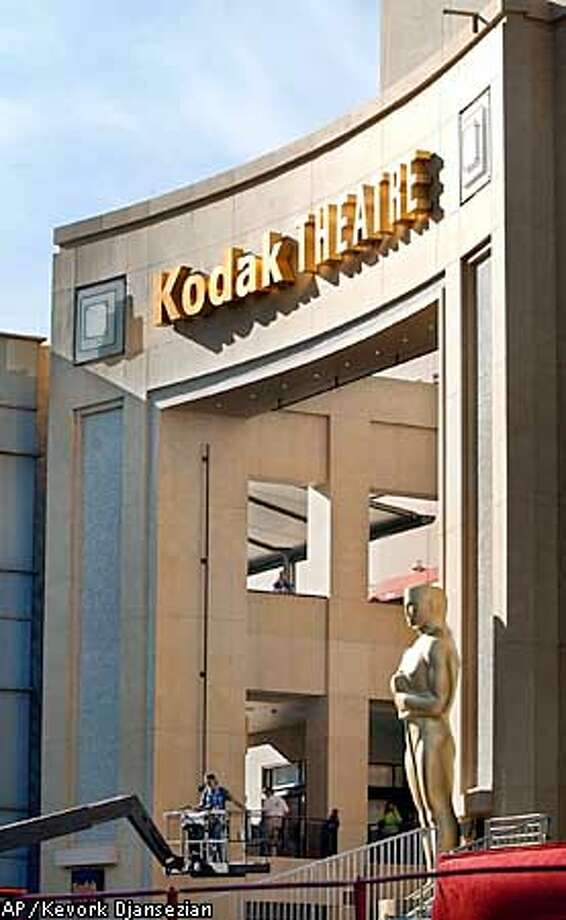 A large Oscar statue is placed at the entrance of the Kodak Theater in Los Angeles, Wednesday, March 20, 2002. Final preparations will continue throughout the week in preparation for the 74th Annual Academy awards show which will take place on Sunday. (AP Photo/Kevork Djansezian) Photo: KEVORK DJANSEZIAN
