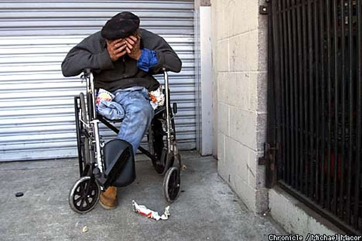 Joe Dinovo, a 31 year old homeless, self-professed crack addict who lost his right leg to cancer a decade ago, sobbing in his wheelchair, as he describes how he was recently in the hospital again with a tumor on his arm. by Michael Macor/The Chronicle