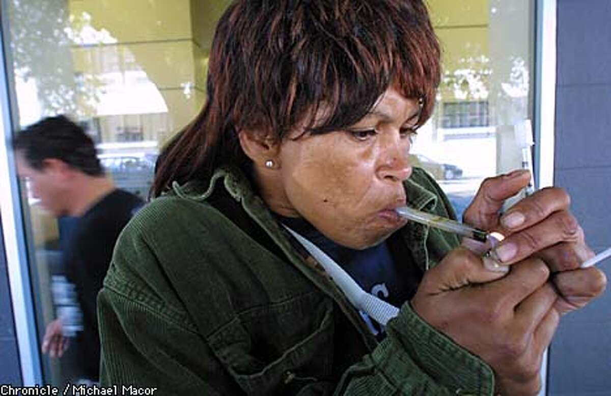 Debra Bailey, 39, a homeless woman smoking crack cocaine and drinking beer outside of a Post Office on Golden Gate Avenue, a day before being arrested in the Tenderloin for buying crack. After 85 days in jail, a judge released Bailey with time served, and she went immediately back to using drugs and protitution. Bailey has had four children by three fathers and 18 seperate criminal cases, including convictions for burglary, drug possession and protitution, and in Marin County in 1988 she was convicted of assault with a deadly weapon. by Michael Macor/The Chronicle