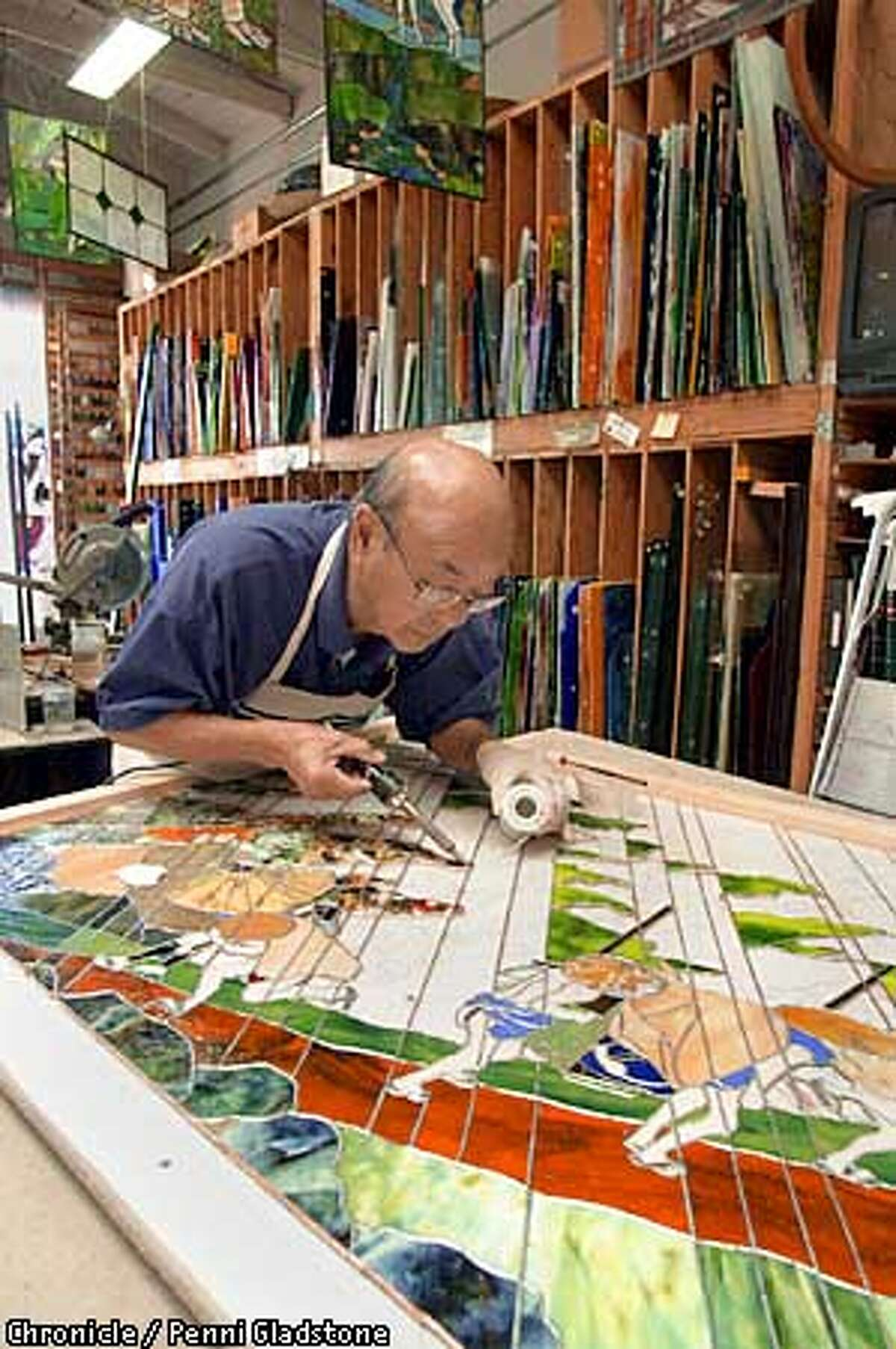 """Aanraku, stained glass studio in San Mateo. Profiled is """"Grandpa,'' Yoshinori Yakao a 79-year-old Japanese cook and swordsman,who started taking classes three years ago and now has a national reputation. CHRONICLE PHOTO BY PENNI GLADSTONE"""