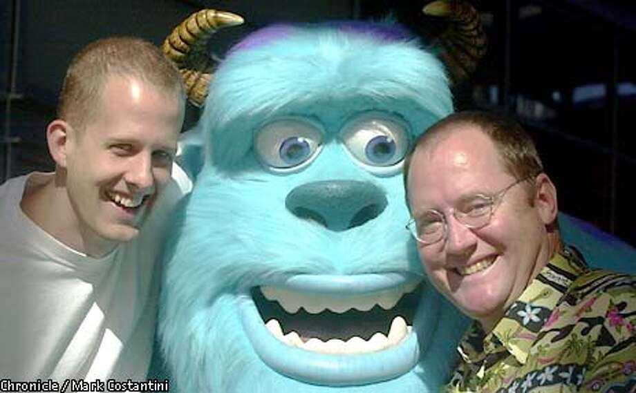 "PIXAR28-C-10OCT01-DD-MC -- Peter Docter, director(left), John Lassiter(right), the head of Pixar . The face in the middle is that of ""Sulley,"" a character in the studio's new movie.  PHOTO: MARK COSTANTINI/THE CHRONICLE Photo: MARK COSTANTINI"