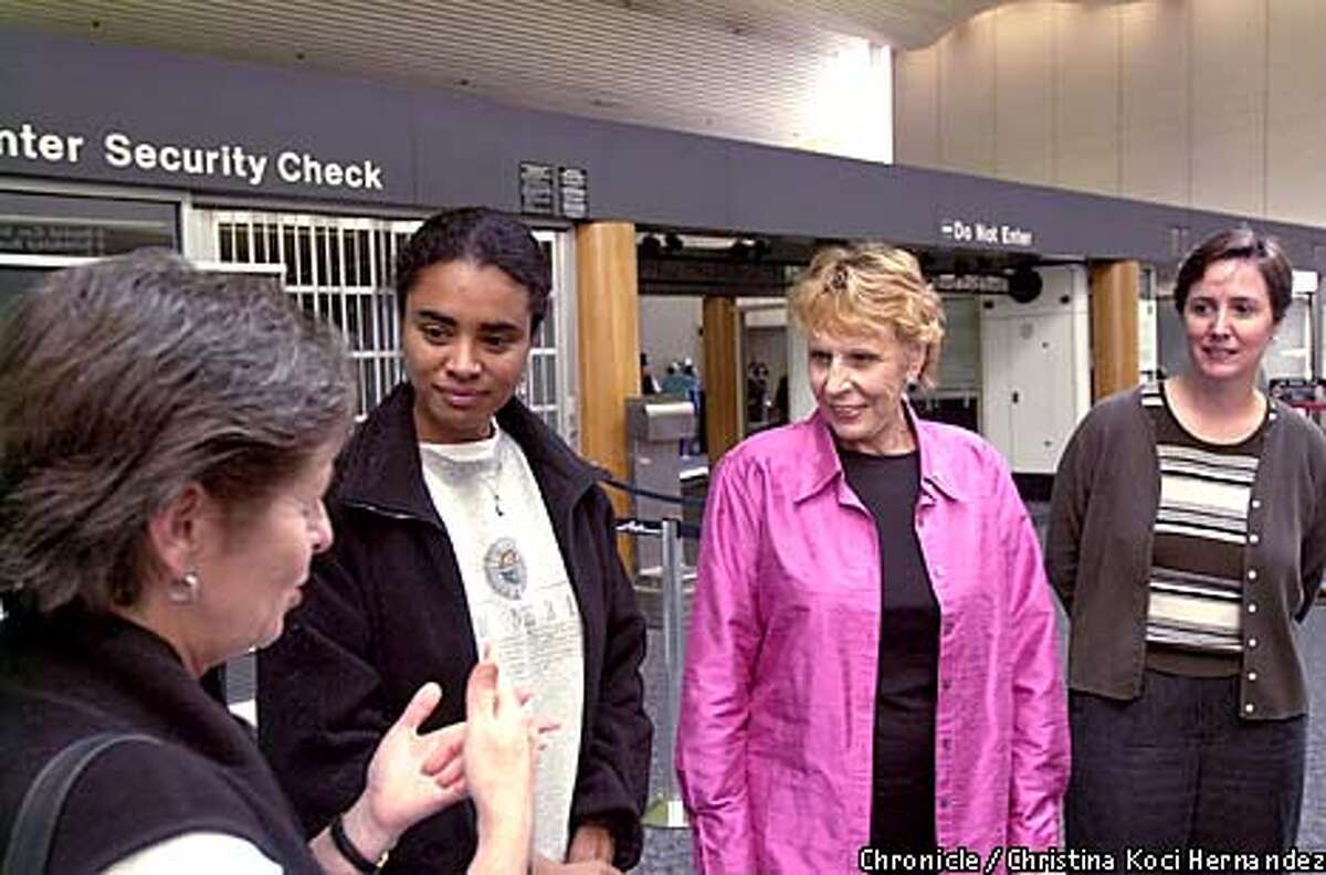 FEARa-C-06OCT01-MT-CKH CHRISTINA KOCI HERNANDEZ/CHRONICLE At the security gate at SFO, Fear of Flying clinic participants after a flight from Seattle to SFO include (L to R): Paula Zimmerman (clinic counselor), Karen Bush (graduate from program after completing this flight), Jeanne McElhattan (clinic instructor) and Sue Patterson (former graduate.)