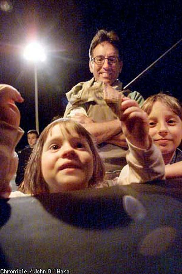 Terra Linda, NOrthgate shopping Center, San Rafael, CA  A large white tent, in the parking lot of Northgate mall, houses this Holloween Haunted house.  Piper Shaw age 4 1/2, with money in hand, headed for the haunted house, sister Paige 7 at right and dad Keith Shaw rear.  Photo/John O'Hara Photo: John O'Hara