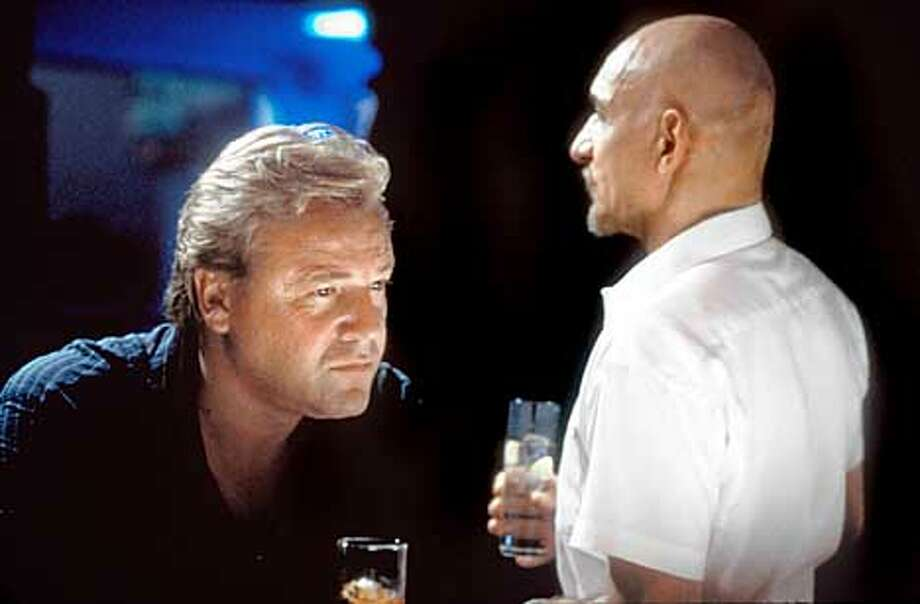 """Don (Ben Kingsley, right) visits retired criminal Gal (Ray Winstone) to persuade him to take one more job in """"Sexy Beast.''"""