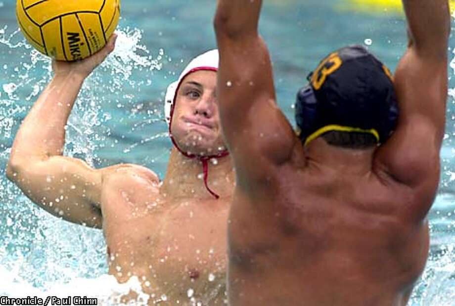 Stanford swimmer Tony Azevedo tried to shoot through Cal's Attila Banhidy at the Spieker Aquatic Center.  PAUL CHINN/S.F. CHRONICLE Photo: PAUL CHINN